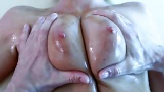 Man is cruelly rubbing her oily peerless tits