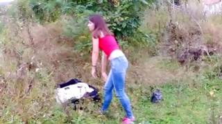 Gorgeous young hoe fingering twat outdoors