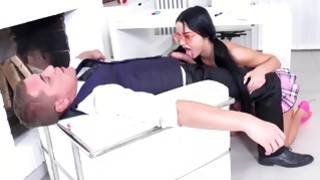 Enticing brunette with sexual glasses is hand jobbing his weenie