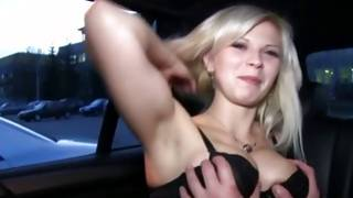 Kinky hot young blondie is posing topless in the car